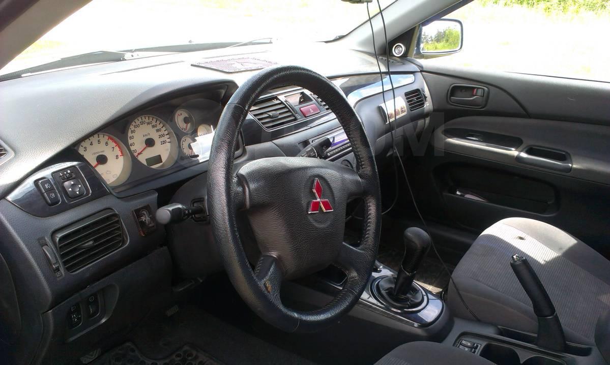 Мицубиси лансер 2005 года фото