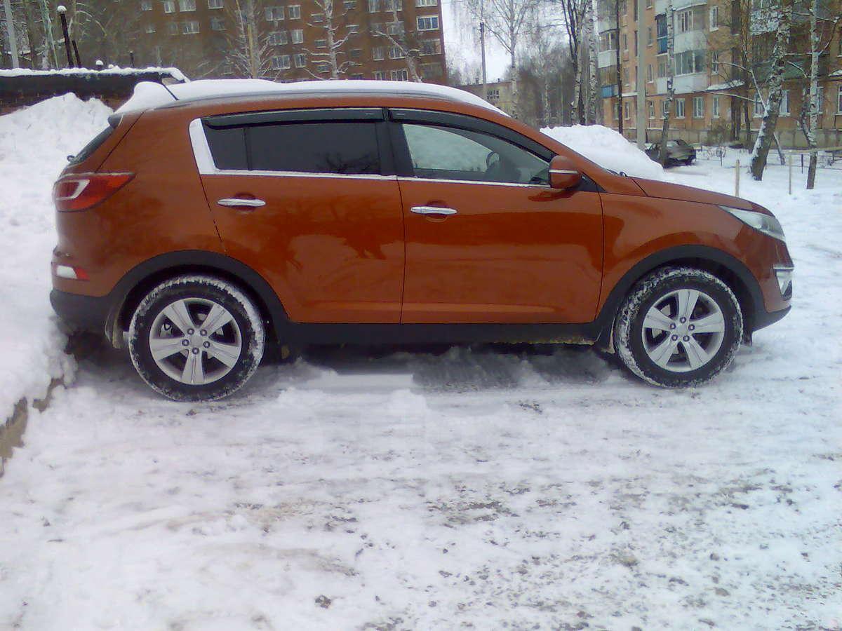 киа спортейдж 3 оранжевый фото