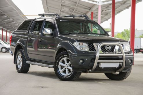 Nissan navara d40 with 2600mm oval steel roof rack pic 2