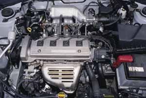 Какой двигатель на тойота карина е