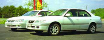 Nissan Bluebird Sylphy и Toyota Corona Premio