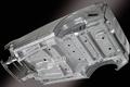 Вваренная в днище монококового кузова рама лестничного типа уже используется, например, в автомобилях Mitsubishi Pajero. В результате применения такой монолитной конструкции увеличивается прочность всего кузова в целом. В частности, если взять последнее поколение Escudo, то его кузов обладает в два раза большей сопротивляемостью к скручиванию. Плюс к этому, несмотря на обилие балок жесткости, разработчики не забыли и о том, чтобы максимально снизить вес машины.
