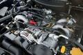 Перед вами - 1.5-литровый атмосферный двигатель, устанавливаемый на седане Impreza и спортивном универсале Impreza Sports Wagon. Его максимальная развиваемая мощность составляет 100 л.с., а наибольший крутящий момент – 14,5 кг/м.