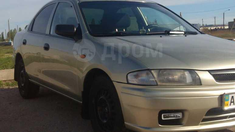Mazda 323, 1997 год, $7000