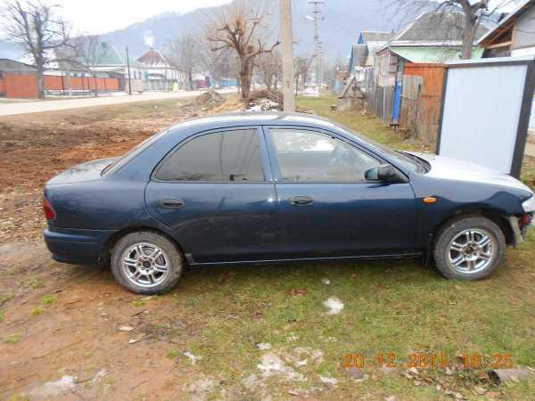 Mazda 323, 1998 год, 140 000 руб.