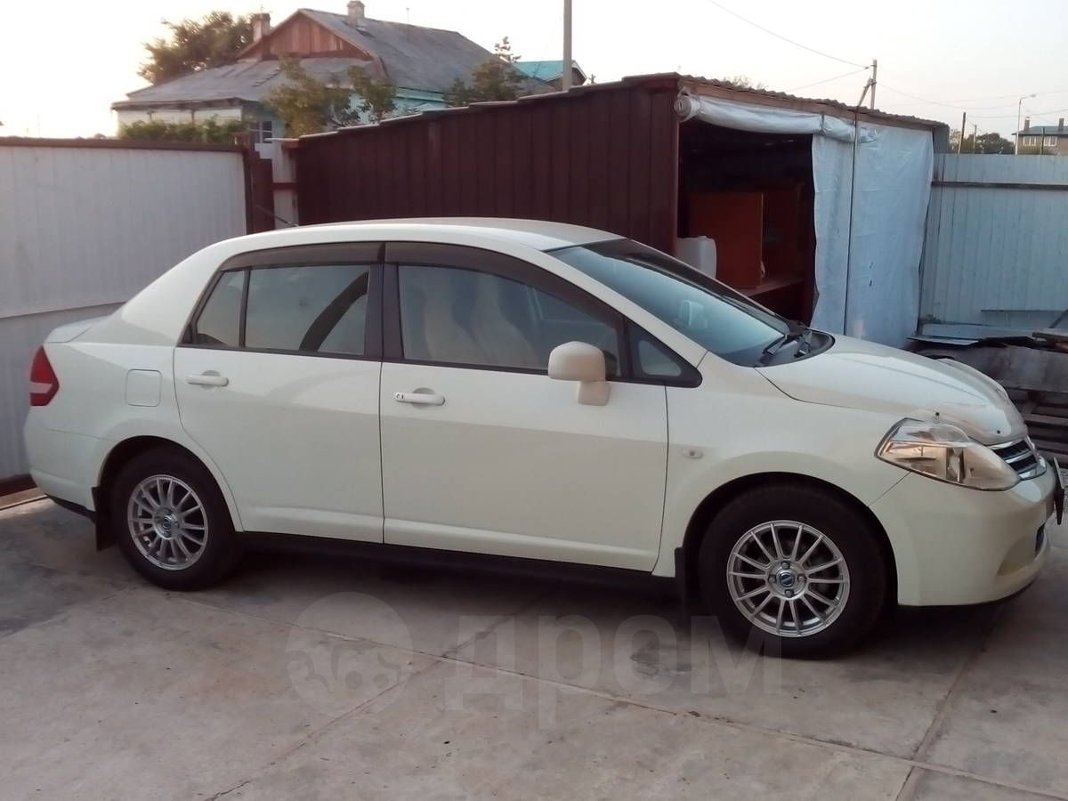 nissan tiida latio комплектации