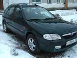 Шумиха Мазда 323Ф 2000