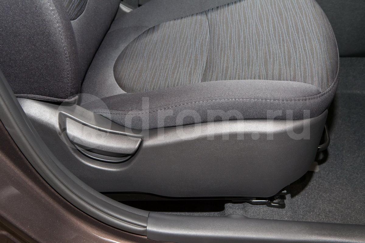 Регулировка передних сидений: Ручная регулировка высоты сиденья водителя