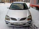 Кызыл Ниссан Тино 1998