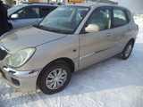Кызыл Тойота Дуэт 2003