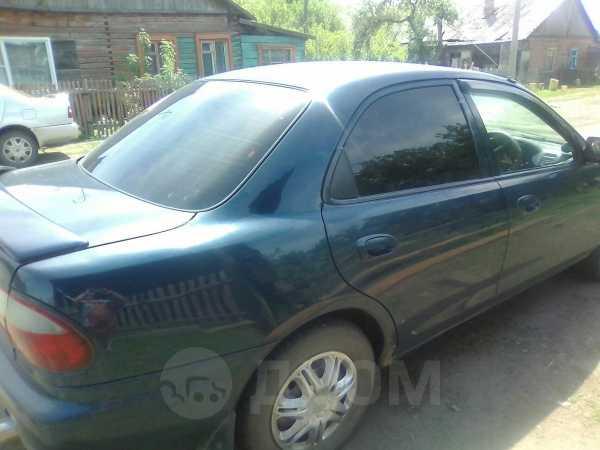 Mazda Familia, 1996 год, 140 000 руб.
