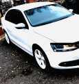 Volkswagen Jetta, 2013 год, 648 000 руб.