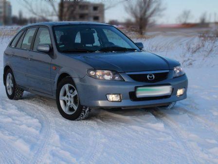 Mazda 323F 2002 - отзыв владельца
