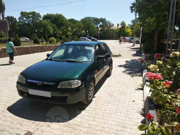 Mazda 323, 1999 год, 165 000 руб.