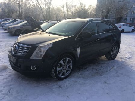 Cadillac SRX 2014 - отзыв владельца